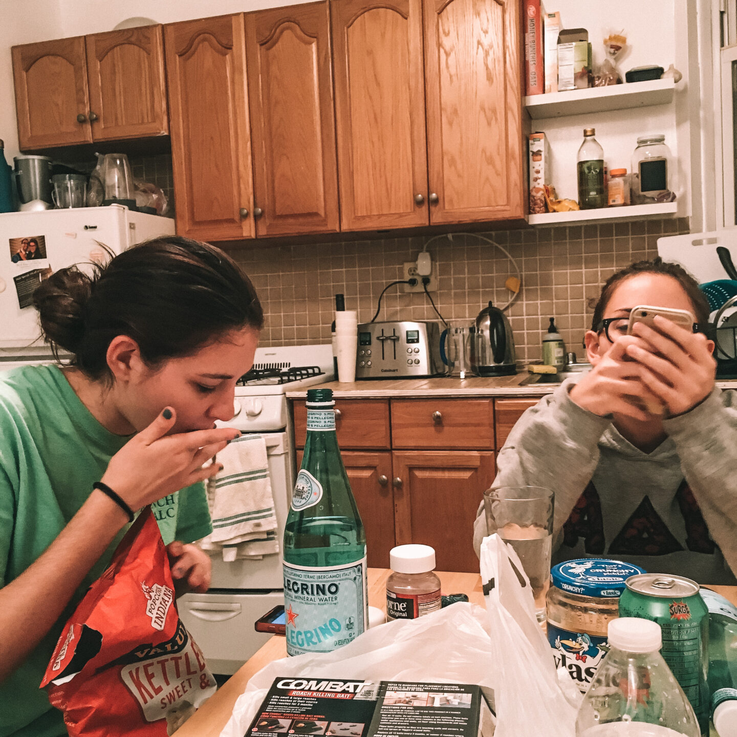 Two roommates snacking and enjoying each others company
